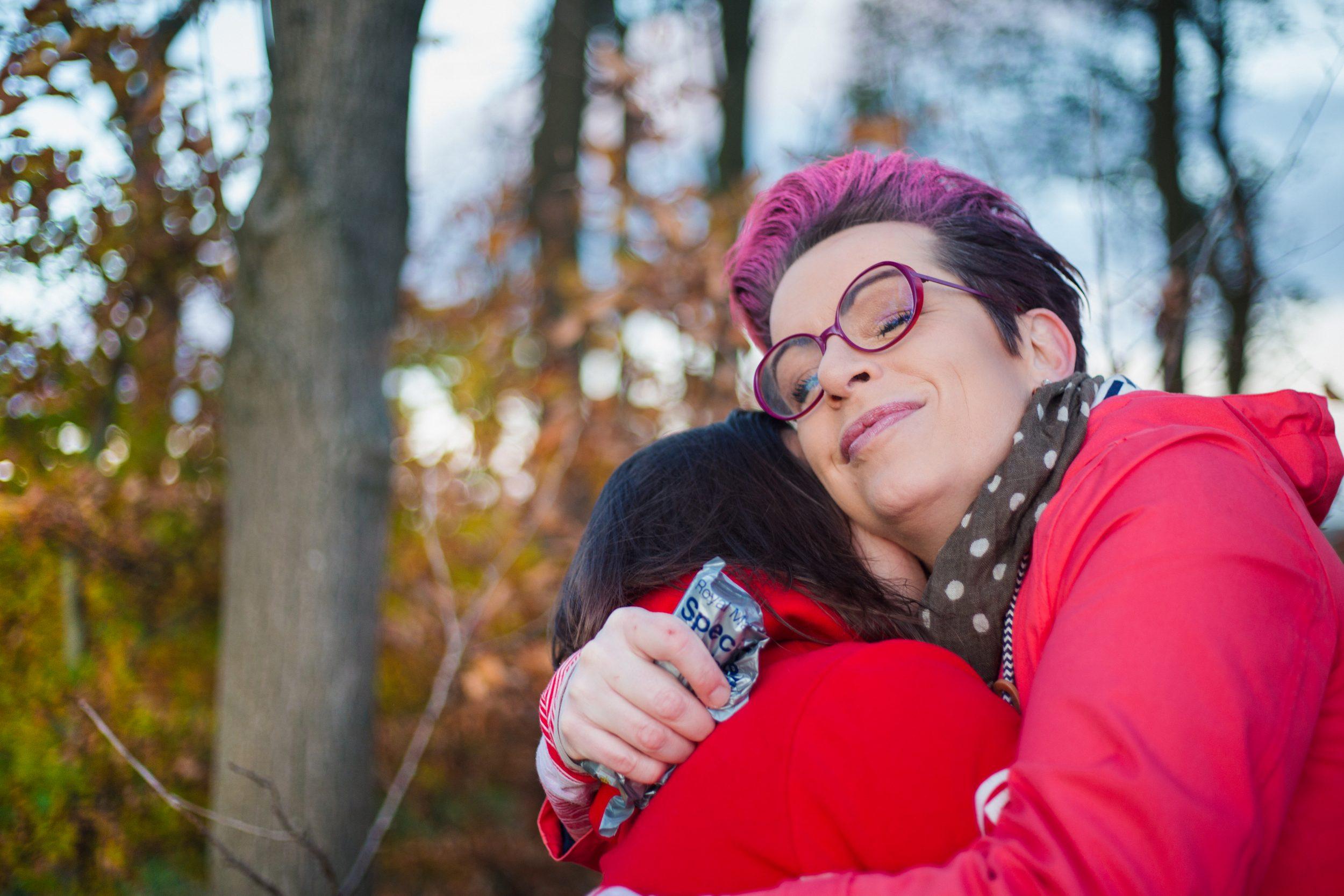 Carrie and Amanda share an intimate hug