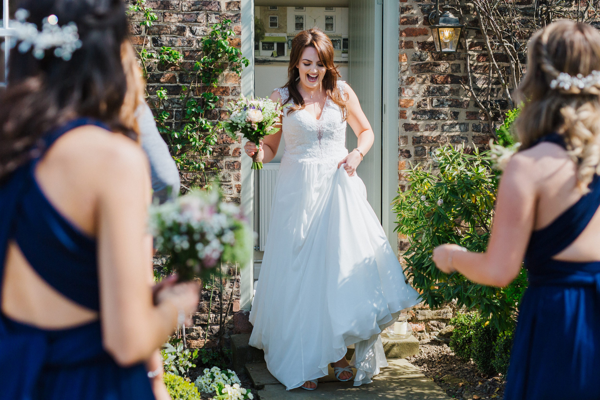 Bride leaving cottage at the Normans in York wedding day