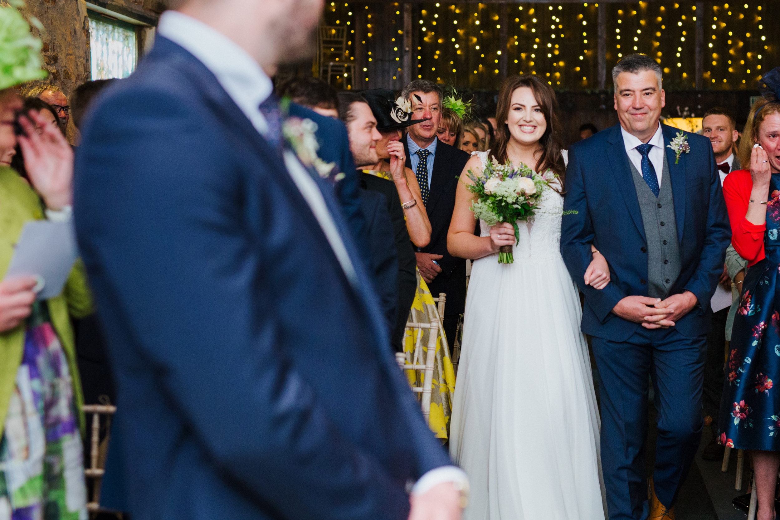 Bride walks down the aisle with her Dad at The Normans in York