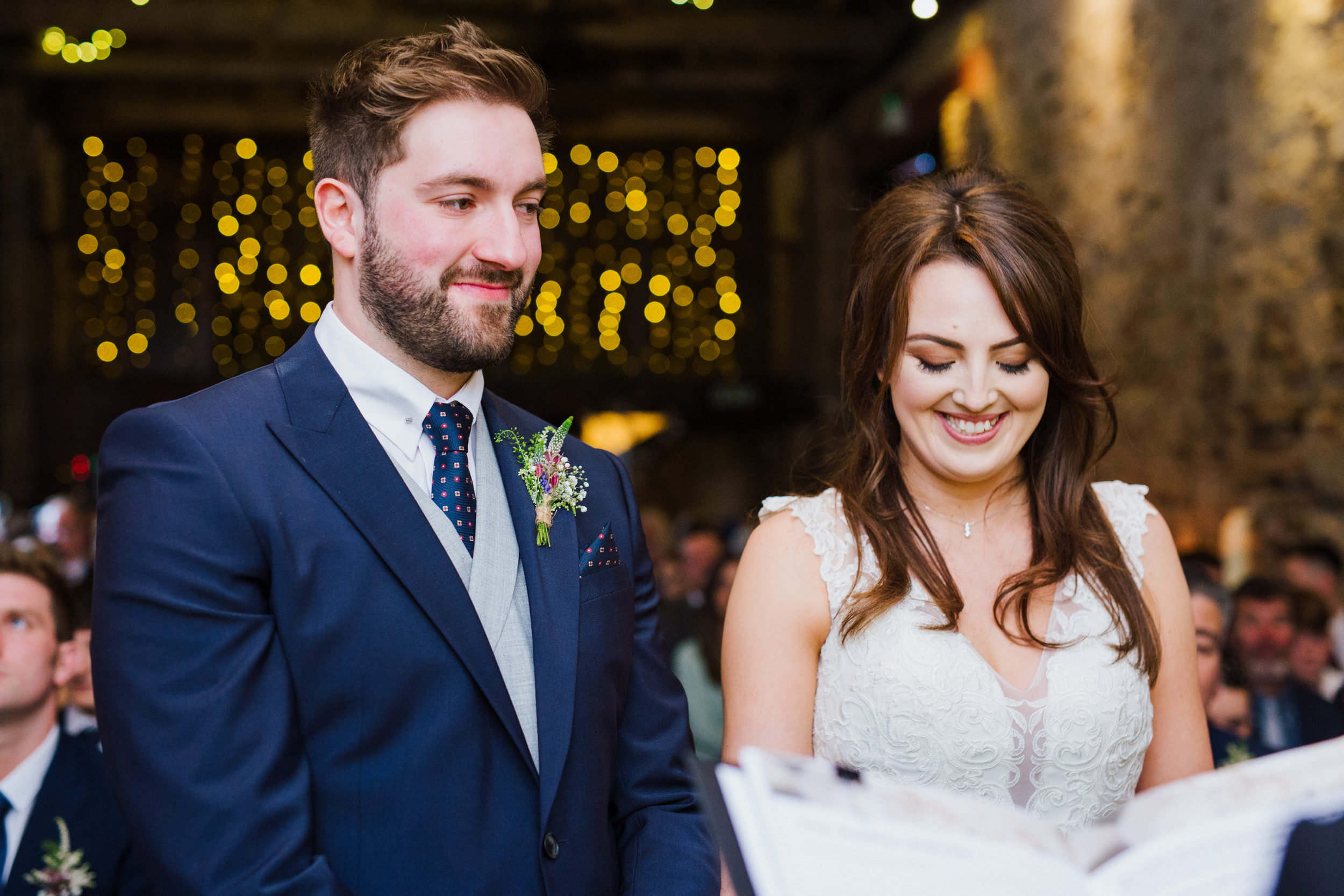 Bride and Groom smiling during their wedding ceremony at The Normans in York